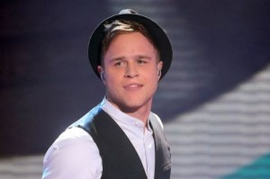 Olly on the X factor with his signature hat